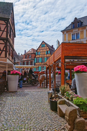 Colmar, France - May 1, 2012: Rue de Turenne in the Old city center in Colmar, Haut Rhin in Alsace, in France. People on the background