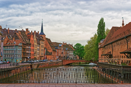 saint nicolas: Quay of Ill River with Spire of St Nicholas Church and Old Custom House in the old town of Strasbourg in Grand East region in France. People on the background