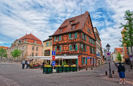 Colmar, France - May 1, 2012: Pfeffel restaurant in half timbered style on Unterlinden Street in the Old city center of Colmar, Haut Rhin in Alsace, in France. People on the background