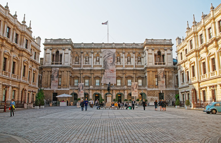 London, England - April 30, 2011: Royal Academy of Arts on Piccadilly, at Burlington House,  in London, the UK. Tourists on the background.