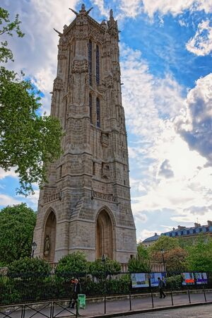Paris, France - May 3, 2012: Saint Jacques Tower in Rivoli Street in central Paris, in France. People on the background