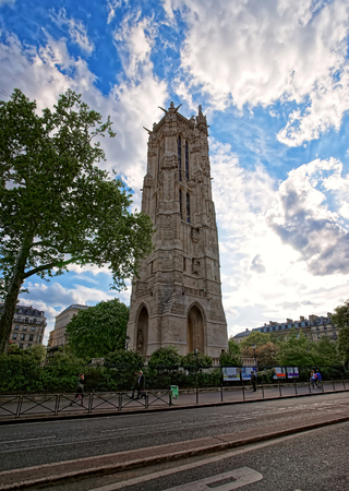 Paris, France - May 3, 2012: Saint Jacques Tower in Rivoli Street in central Paris in France. People on the background