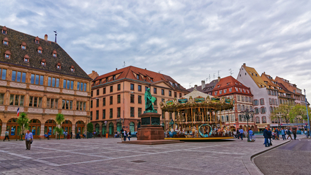 Strasbourg, France - April 30, 2012: Place Gutenberg Square in the historic center, or Grande Ile in Strasbourg in Grand East region, of France. People on the background