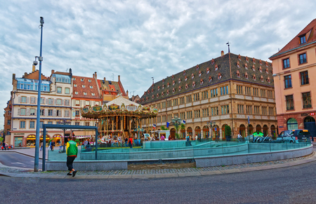 Strasbourg, France - April 30, 2012: Chamber of Commerce building and Place Gutenberg Square in the historic center, or Grande Ile in Strasbourg in Grand East region, of France. People on the background Editorial