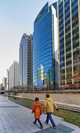 Seoul, South Korea - March 11, 2016: Urban park and Cheonggyecheon public recreation walkway of Seoul, South Korea. People passing by Editorial