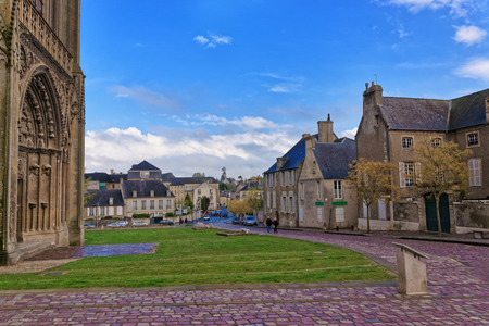 Street and fragment of Cathedral of Our Lady of Bayeux in Calvados department of Normandy, France. People on the background