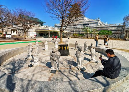 ethnographical: Seoul, South Korea - March 11, 2016: Twelve Zodiac animal deities near National Folk Museum of Korea in Gyeongbokgung Palace in Seoul, South Korea. People in the street
