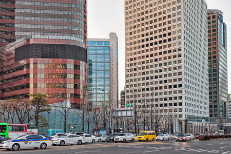jung: Seoul, South Korea - March 11, 2016: Skyscrapers and cars in the road in Jung district in Seoul, South Korea