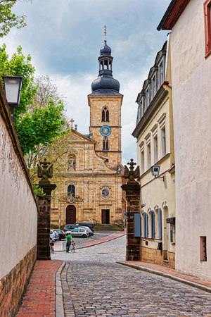 st german: St Jakob Church in the city center of Bamberg, Germany. It is also called Jakobsskirche, a Roman basilica. People on the street Editorial