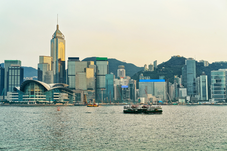 hong kong island: Star ferry at the Victoria Harbor in HK at sundown. View from Kowloon on Hong Kong Island.