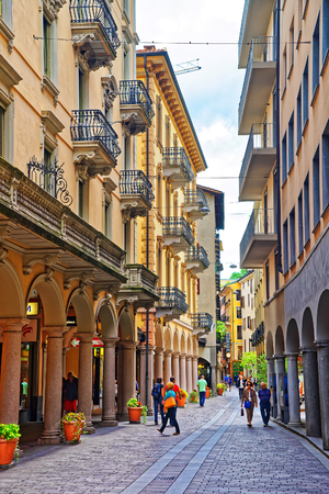 Lugano, Switzerland - August 26, 2013: Street in the city center in luxurious resort Lugano in Ticino canton of Switzerland. People on the background