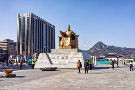 king street: Seoul, South Korea - March 11, 2016: Statue of the King Sejong at Gwanghwamun square in Seoul, South Korea. People in the street Editorial