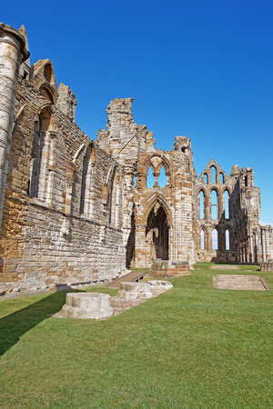 abbey ruins abbey: Whitby Abbey in North Yorkshire in the UK, ruins of Benedictine abbey. Now it is under protection of the English Heritage.