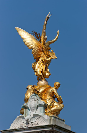angels fountain: London, England - April 30, 2011: Victoria Memorial in London in England. It is placed in the Mall in the downtown of the city. Stock Photo