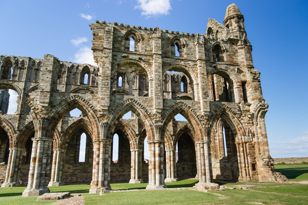 Whitby Abbey, in North Yorkshire in the UK. It is ruins of the Benedictine abbey. Now it is under protection of the English Heritage. Stock Photo
