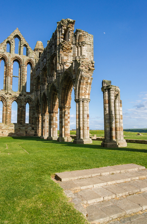 abbey ruins abbey: Whitby Abbey in North Yorkshire in UK. It is ruins of the Benedictine abbey. Now it is under protection of the English Heritage.