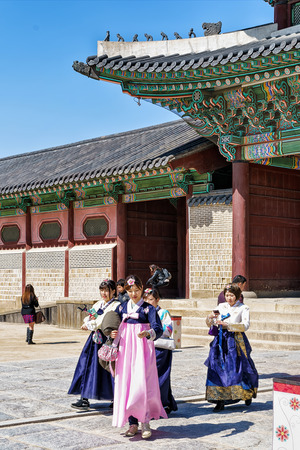 Seoul, South Korea - March 11, 2016: Young girls in traditional dresses at Gyeongbokgung Palace of Seoul, South Korea Editorial