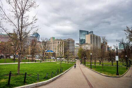 common people: Boston, USA - April 27, 2015: Boston Common public park in downtown Boston, Massachusetts, the United States. People on the background