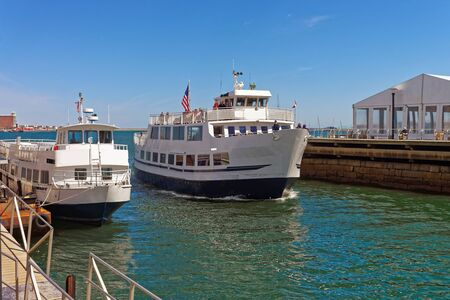 People spend time while traveling with ferry boat in Boston, USA. It is very common to use boats in the city because it is located near the water facilities such as Massachusetts Bay.