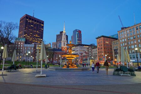 Boston, USA - April 28, 2015: Fountain at Boston Common public park of downtown Boston, Massachusetts, the United States. Park Street Church and People on the background. Late in the evening Editorial