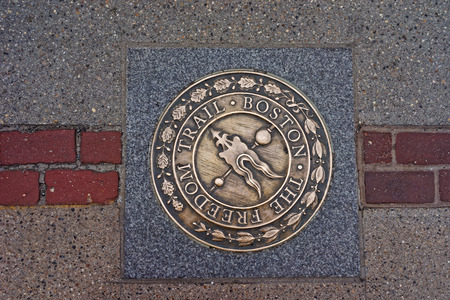 Freedom Trail symbol on the road in downtown Boston, Massachusetts, the United States