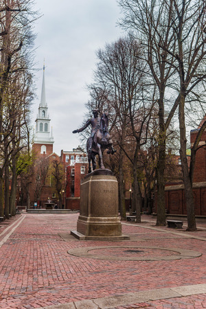 revere: Boston, USA - April 28, 2015: Old North Church and Statue of Paul Revere in downtown Boston, Massachusetts, the United States. People on the background
