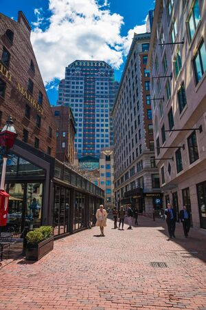 Boston, USA - April 29, 2015: Marketplace at Faneuil Hall Square of downtown Boston, Massachusetts, the United States. People on the background.