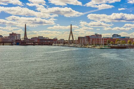 leonard: Harbor and Zakim bridge with the skyline of Boston, USA. The full name of the bridge is The Leonard P Zakim Bunker Hill Memorial Bridge and it was opened in 2003. It is located across Charles river. Stock Photo