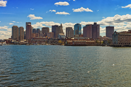 One of the side of the river Charles and the skyline of Boston in the United States. The city is home for 251 completed skyscrapers. It is located near water and boats are common type of transport.