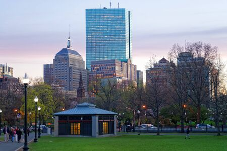 common people: Boston, USA - April 27, 2015: Skyline and Boston Common public park in downtown Boston, Massachusetts, the United States. People on the background. In the evening