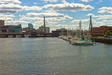 Pier 6 with sailboats at Charles River and Leonard P Zakim Bunker Hill Memorial Bridge with the skyline of Boston, Massachusetts, USA.