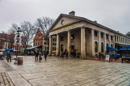 Boston, USA - April 27, 2015: Quincy Market at Faneuil Hall Marketplace in downtown Boston, Massachusetts, the United States. People on the background.