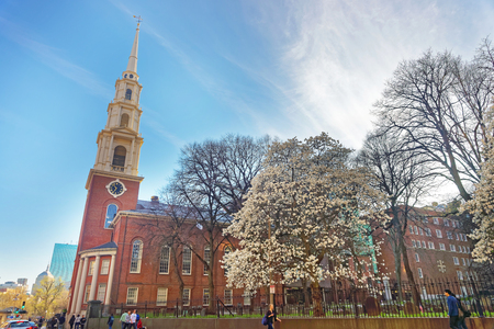 Boston, USA - April 28, 2015: Park Street Church and Granary Burying Ground in Tremont Street in downtown Boston, Massachusetts, the United States. People on the background
