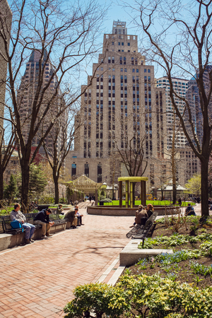 Boston, USA - April 28, 2015: Post Office Square and Skyline with Skyscrapers of downtown Boston, MA, USA. People on the background Editorial
