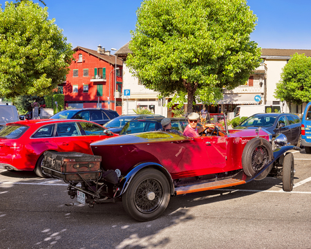 Ascona, Switzerland - August 23, 2016: Rolls Royce Retro car in the street of Ascona, Ticino, Switzerland. With driver and passenger in the car Editorial
