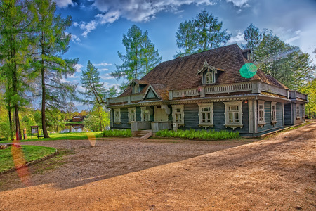 Old wooden house at Bialowieza National Park as a part of Belovezhskaya Pushcha National Park in Poland.