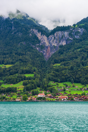 canton berne: Traditional Swiss chalet at Lake Brienz and Brienzer Rothorn mountain at Interlaken in Canton of Bern in Switzerland Stock Photo