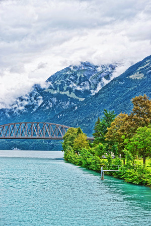 canton berne: Bridge over Lake Brienz and Brienzer Rothorn mountain on the background at Interlaken in Canton of Bern in Switzerland Stock Photo