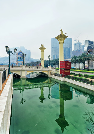 dreams of city: Macao, China - March 8, 2016: City of Dreams and Canal of Venetian Macau Casino luxury resort in Macao, in China. People on the background