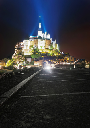 church steeple: Mont Saint Michel in Normandy region of Manche department in France, illuminated with light in the evening Stock Photo