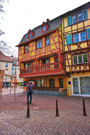 haut rhin: Colmar, France - May 1, 2012: Colorful Timber framing houses on Rue des Tetes Street in the old city center of Colmar, Haut Rhin in Alsace, of France. People on the background Editorial
