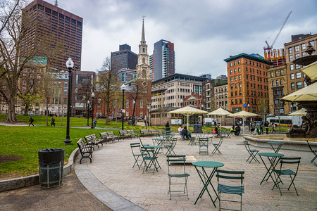 Boston, USA - April 27, 2015: Park Street Church and Boston Common public park in downtown Boston, Massachusetts, the US. People on the background Editorial