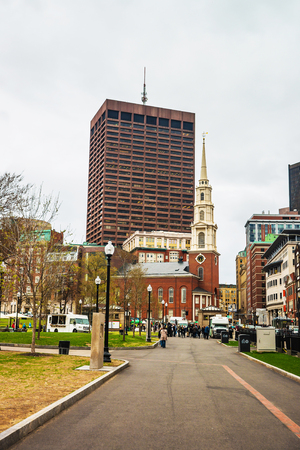 common people: Boston, USA - April 27, 2015: Park Street Church in Boston Common public park in downtown Boston, Massachusetts, the United States. People on the background Editorial