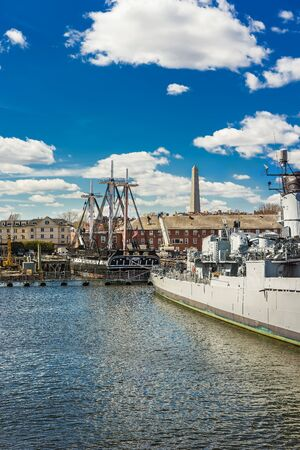 Ships at Charlestown peninsula and Bunher Hill Monument on the background in Boston, Massachusetts, the USA. Stock Photo