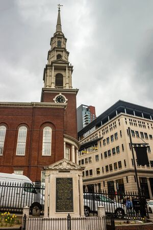 Boston, USA - April 27, 2015: Park Street Church at downtown Boston, Massachusetts, the United States. People on the background
