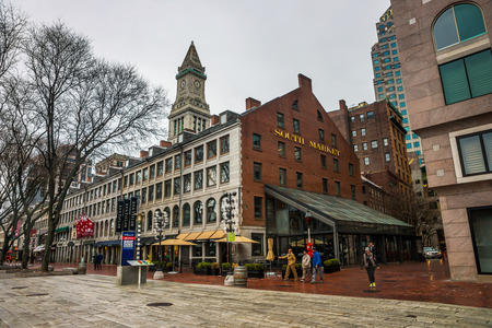 Boston, USA - April 27, 2015: Custom House Tower and South Market at Faneuil Hall Marketplace in downtown Boston, Massachusetts, the United States. People on the background.