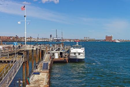 wharf: Pier of Boston Wharf with sailboat and Charles River,  Boston, Massachusetts, the United States. Stock Photo