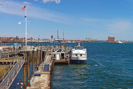 Pier of Boston Wharf with sailboat and Charles River,  Boston, Massachusetts, the United States. Stock Photo