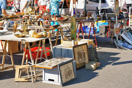 Ascona, Switzerland - August 23, 2016: Various goods for selling at the counter in the flea street market in Ascona, Lake Maggiore, Ticino canton, Switzerland.