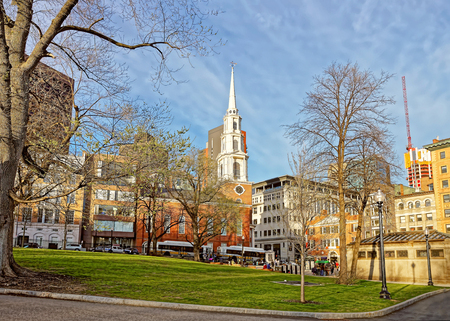 Park Street Church in Boston Common public park in downtown Boston, Massachusetts, in the United States. People on the background Stock Photo